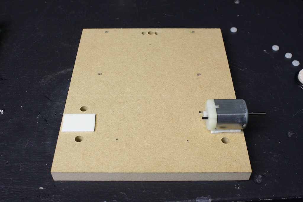 Apply double-sided tape between the motor and MDF base.